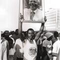 Young man displaying photo of Mandela, Defend Natal march, 7 July 1990 (photo - Jeeva Rajgopaul)