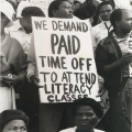 Worker with placard demanding paid time-off to attend literacy classes, Curries Fountain rally, before 'Defend Natal' march, Saturday 9 July 1990 (photo - Jeeva Rajgopaul)