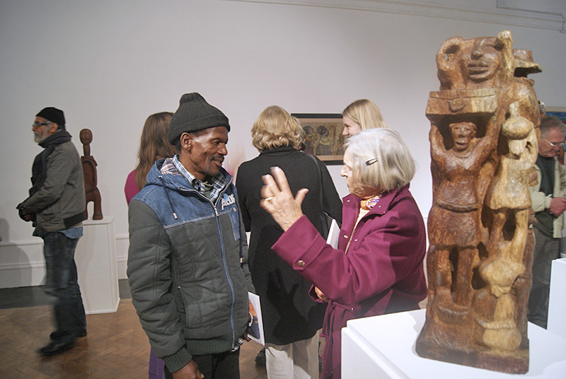 Against the Grain - Shepherd Mbanya engaged by a visitor, ISANG, 14 August 2013 (photo: J. Erasmus)