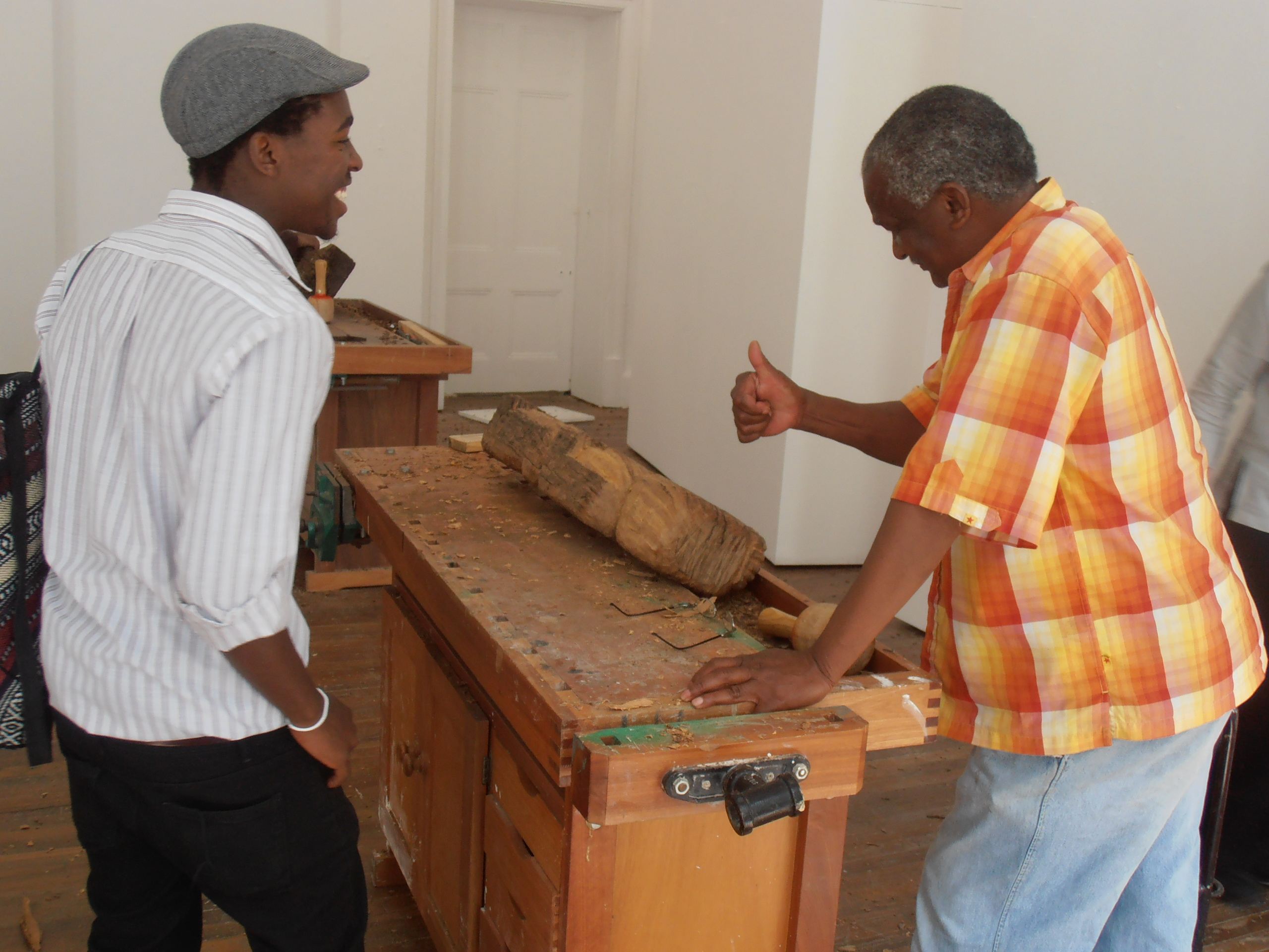 Against the Grain - Ishmael Thyssen (right) talking with a student who visited the workshop