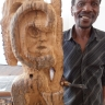 Against the Grain - Shepherd Mbanye posing with his work