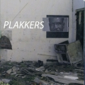 Plakkers, cover