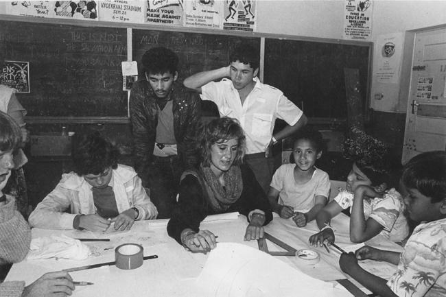 Children look in on CAP workshop, c. 1985