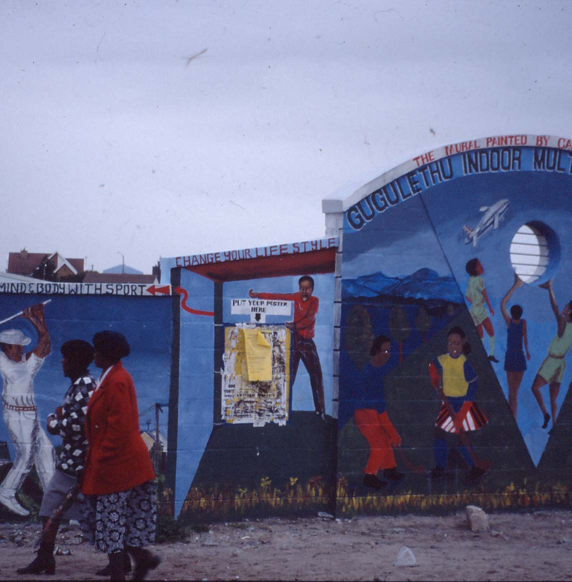 Khanya Mehlo, Liza Jacobs, Ernest Fulani and Shakes Tembani. Mural, Facilitators: Sipho Hlati and Tony Mhayi. Gugulethu Indoor Multisport Complex