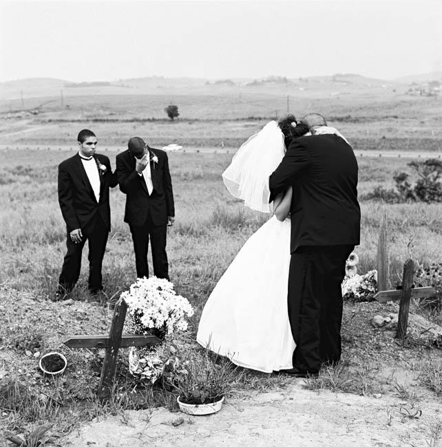 Deborah Eksteen is comforted by her groom Noel Norris. Mangete, KwaZulu Natal, 2001. Artist's collection Photo: C Nunn. Visiting the grave of her recently deceased father immediately after her marriage