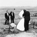 Deborah Eksteen is comforted by her groom Noel Norris. Mangete, KwaZulu Natal, 2001. Artist's collection Photo: C Nunn. Visiting the grave of her recently deceased father immediately after her marriage