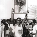 Young man displaying photo of Mandela, Defend Natal march, 7 July 1990 (photo - Jeeva Rajgopaul)