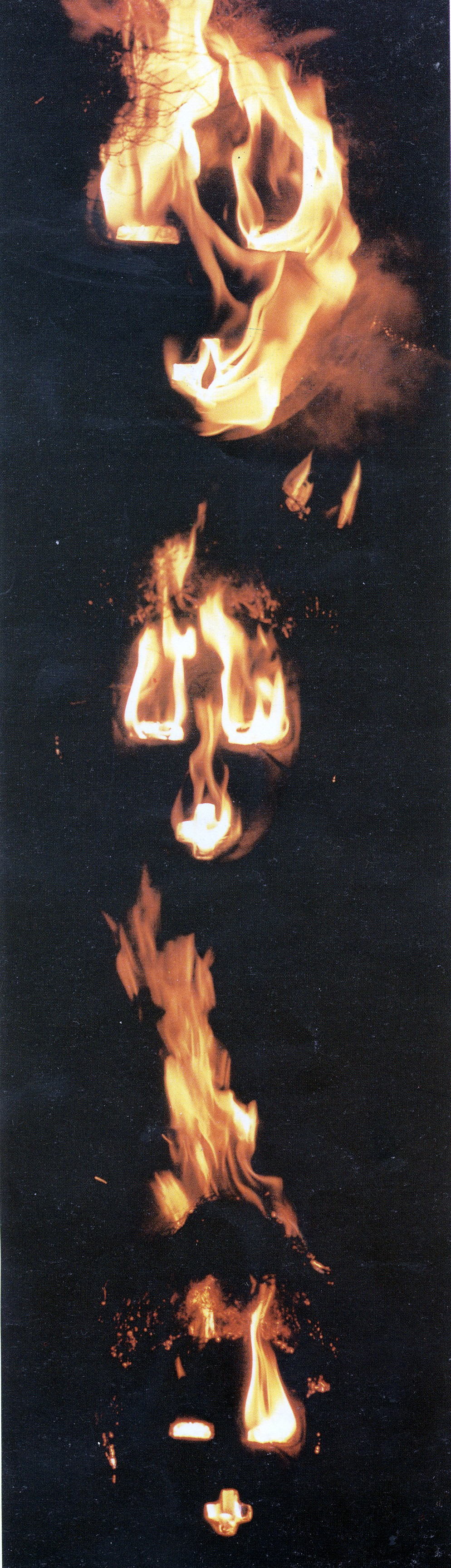 Para Noire (detail of event), 1996. Wood and grass, 228 x 123 x 22 cm. Set alight before assembled audience, Harare (Photo: B Murray. Published in Gallery)