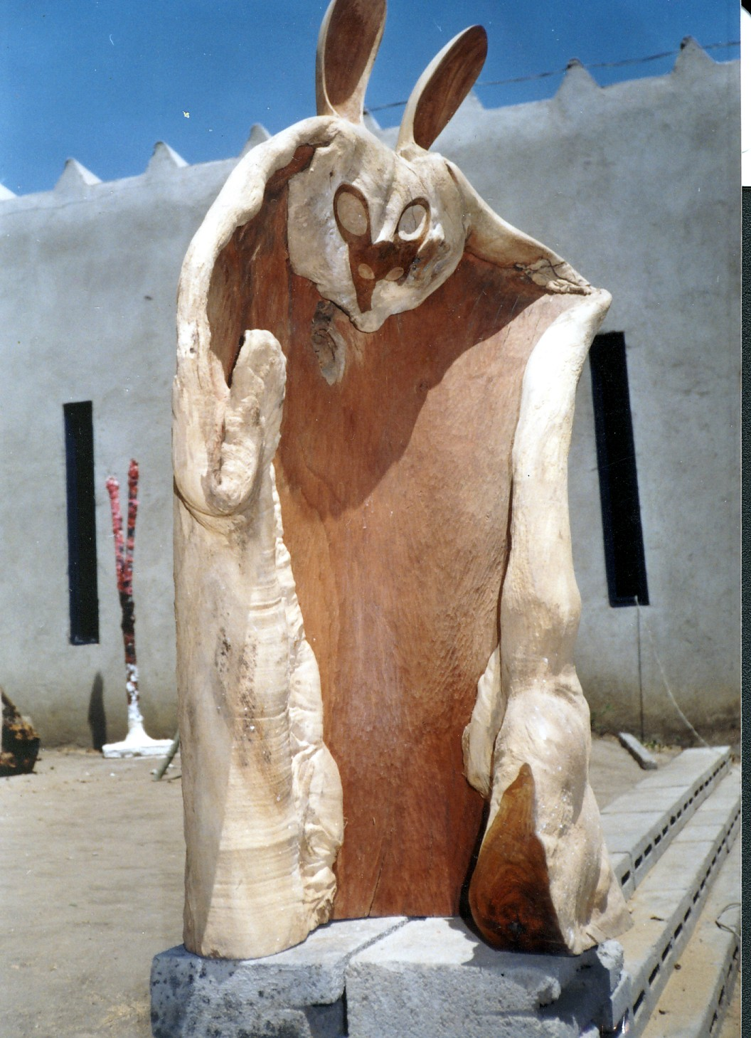 The eyes of the rabbit are the ears of the jackal aka Twentieth Century Fox, 1997. Cuban mahogany, 135 x 65 cm. (Collection: Diehleman Gallery, Brussels; (Photo: G Dixon) Note: The house designed by the artist is in the background