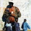 Isaac Nkululeko Makeleni  - Carving a doll's head, Nyanga East, probably mid-to-late 1990s (Photo: courtesy M. Makeleni)