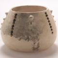 <em>Bowl I</em>, 2005. Smoked earthenware and tacks, 13.5 x 18.5 cm (Image courtesy of DAG)