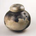 <em>Jar with lid</em>, 2006. Smoked earthenware, 17.6 x 17 cm (Image courtesy of DAG)