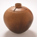 <em>Water jar</em>, 2006. Smoked terracotta and tacks, 25 x 25 cm (Image courtesy of DAG)