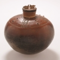<em>Two Bushpigs Jar</em>, 2006. Smoked terracotta, 23 x 22.5 cm (Image courtesy of DAG)