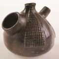 <em>Waterpipe</em>, 2007. Smoked earthenware and white clay, 9.2 x 9.8 cm (Image courtesy of DAG)
