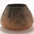<em>Bowl with mask</em>, 2005. Smoked earthenware and terracotta, 12.5 x 18 cm (Image courtesy of DAG)