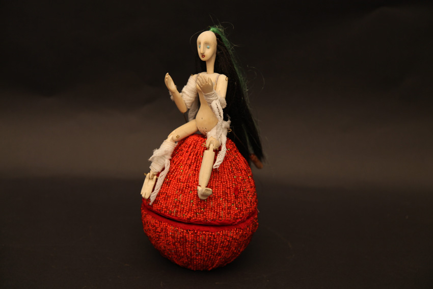 Transformed Apple Girl, 2012. Wood, cloth, beads, leather and nylon
