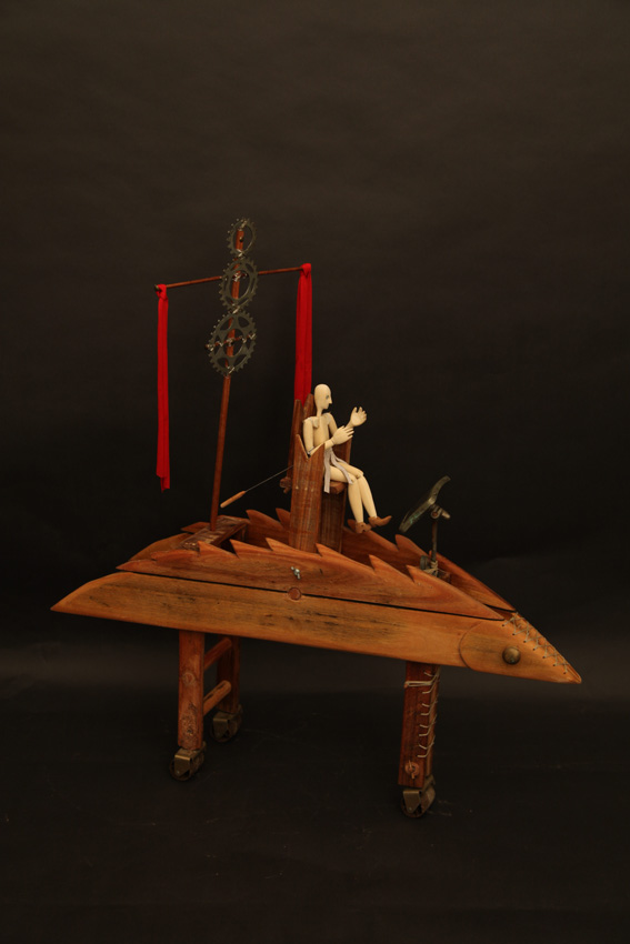 The King's War Chariot, 2012. Wood, wax string, beads, bandages, leather and found objects