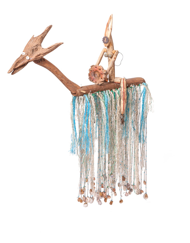 Queen X, 2016. Wood with beads, wire, metal, cowrie shells and other found objects, 91 x 104 x 18 cm