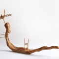 Guardian of the Lethe, 2018. Wood and root with cowrie shells and feathers, 37 x 66 x 20 cm