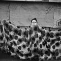 Omar Badsha - Young woman and washing, Inanda