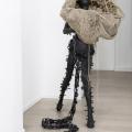 <em>Revenants III</em>. 2017. Recycled rubber & Hessian on fibreglass cast. 118x116x72cm