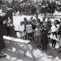 Retired teacher teaching kids outside the Thuthukani Community Centre