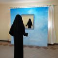 <em>Hidden, unseen, unheard</em>. 2010. Mannequin, dress, mirror & plywood. 4x4x3m