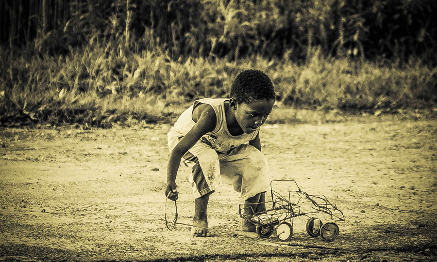 Child playing with toy car, 2016