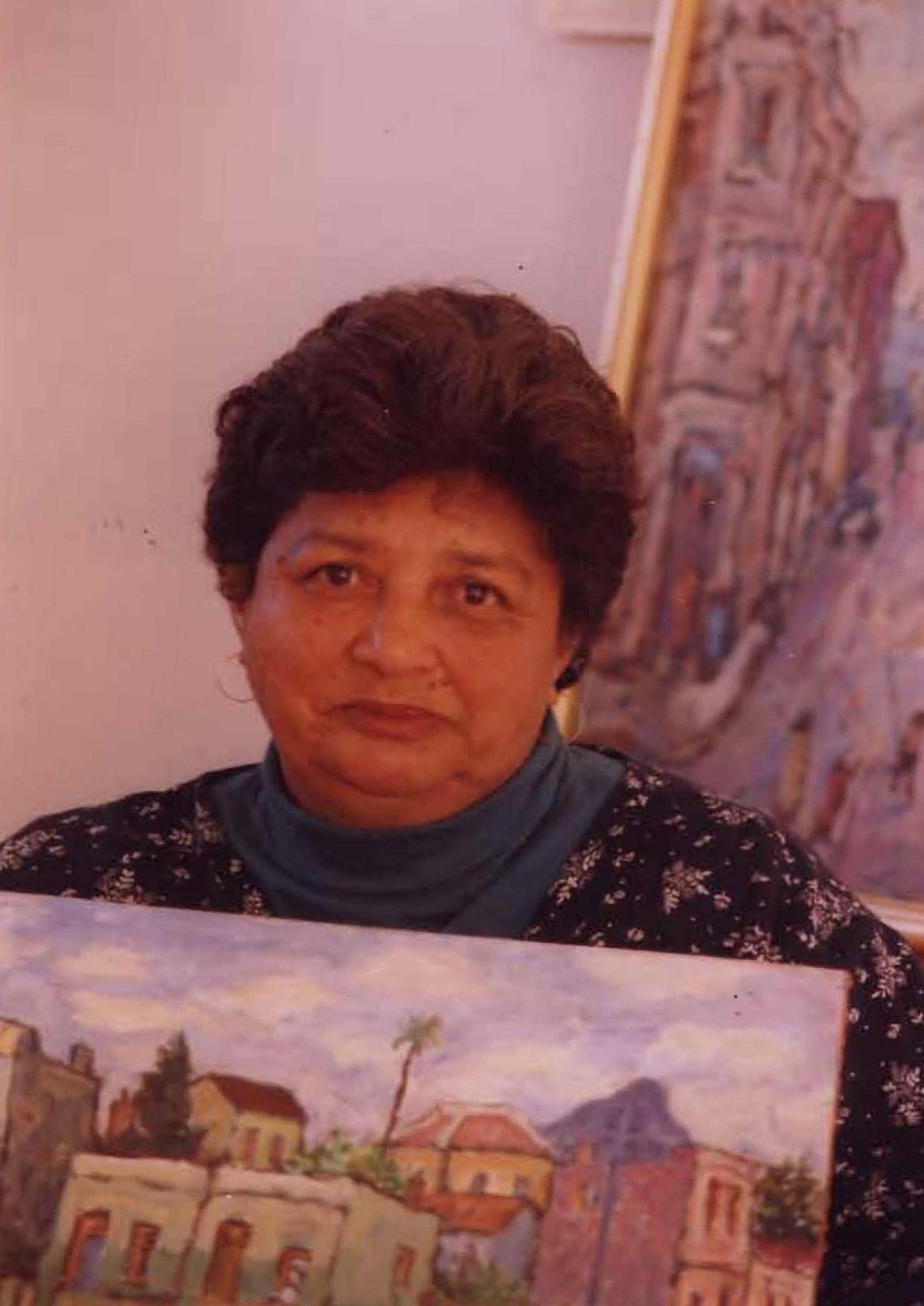 Vakalisa - Joan Baker, writer, with paintings by Kenny Baker (photo: courtesy Mervyn Davids)