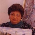 Vakalisa - Joan Baker, writer, with paintings by Kenny Baker (photo: courtesy Mervyn Davids)